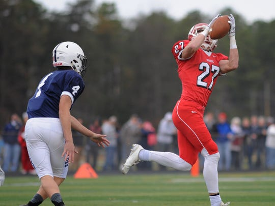 Lenape receiver Jake Topolski pulls in a pass en route to a 70-yard touchdown in the first quarter of Thursday's game against Shawnee.