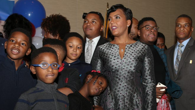 Atlanta mayoral candidate Keisha Lance Bottoms stands with family and friends before declaring victory during an election-night watch party Wednesday, Dec. 6, 2017, in Atlanta.