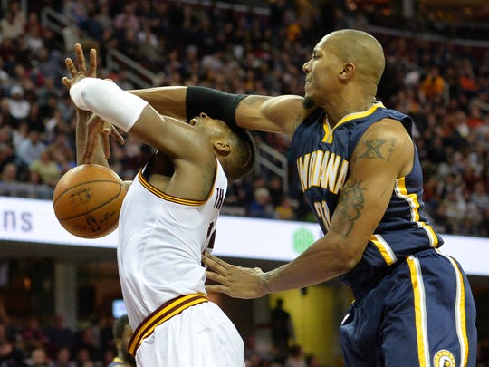 Cleveland Cavaliers forward Tristan Thompson (left) is fouled by Indiana Pacers forward David West (21) in the third quarter at Quicken Loans Arena.