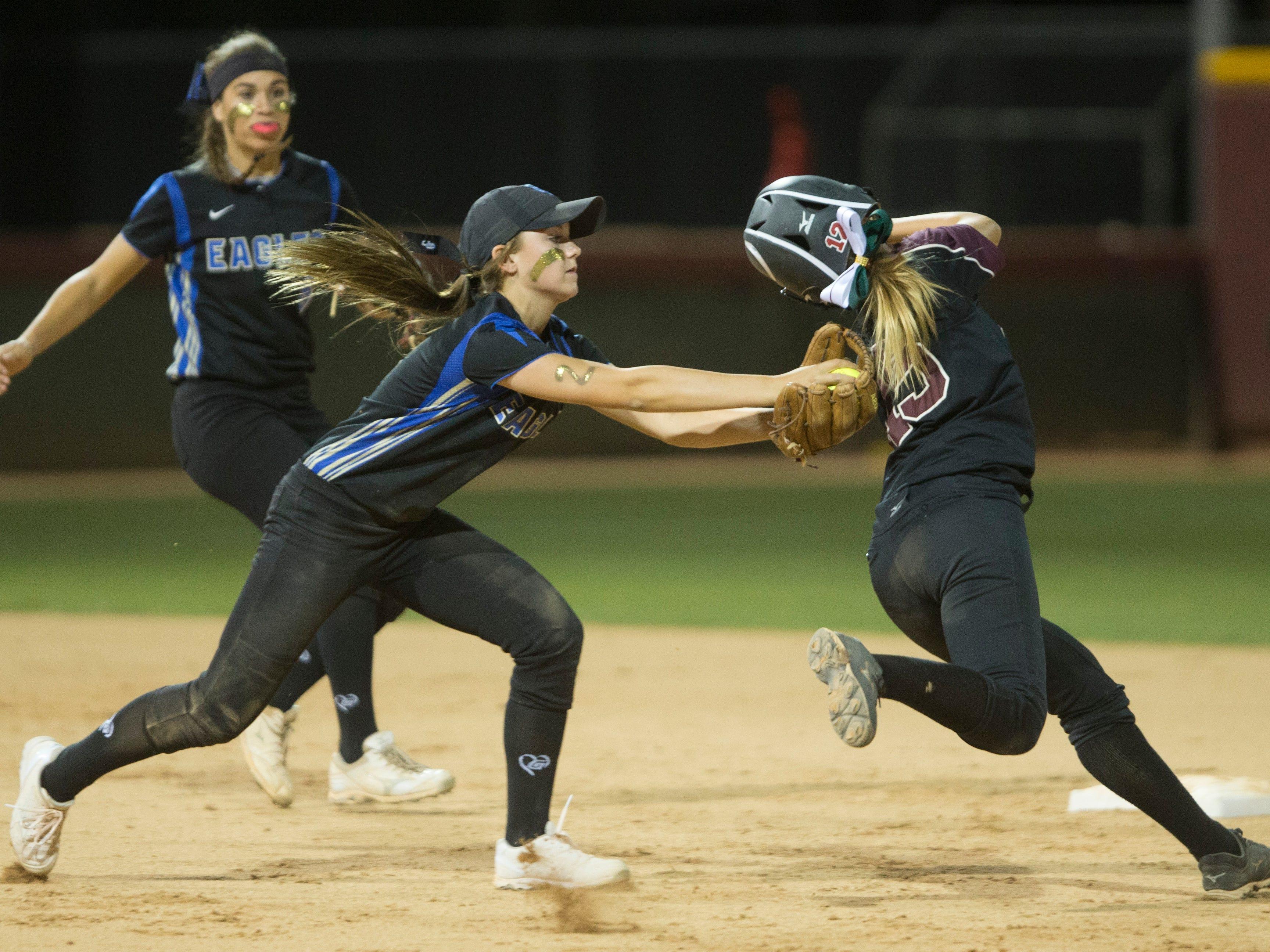 Sandra Day O'Connor's Savanna Avilla (2) tags Mountain Ridge's Jailene Carpio (15) as she heads to second base during the D1 State Softball Championship at Farrington Softball Stadium in Tempe, AZ on May 18, 2015.