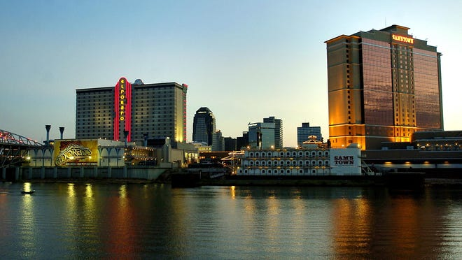 The downtown Shreveport skyline glitters over the Red River after sunset.