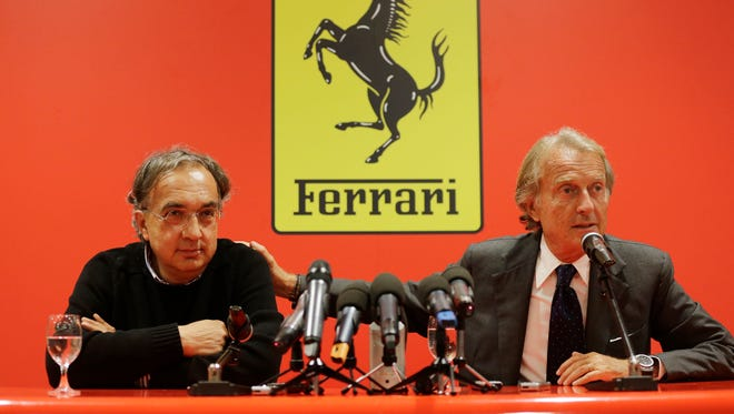 Fiat-Chrysler CEO Sergio Marchionne, left, and outgoing Ferrari President Luca Di Montezemolo address the media during a press conference at Ferrari headquarters in Maranello, Italy, Wednesday.