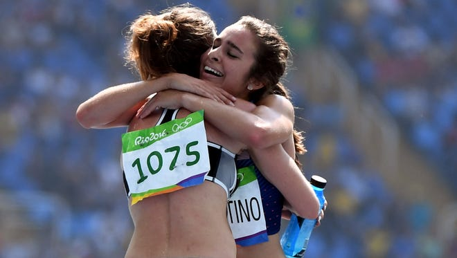 Abbey D'Agostino (USA) and Nikki Hamblin (NZL) embrace after a qualifying race at the Olympics, during which they helped each other up from falls.