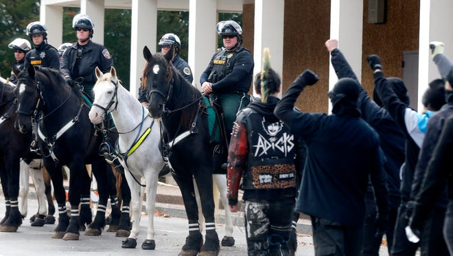 Law enforcement officers watch from horseback as Antifa members march to the White Lives Matter rally on the square in Murfreesboro, on Saturday, Oct. 28, 2017.