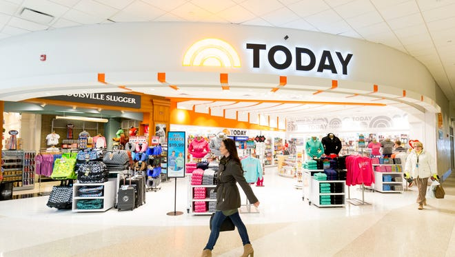 Travelers walk past the new TODAY store at Louisville International Airport. Louisville is the first airport in the country to have a TODAY store.