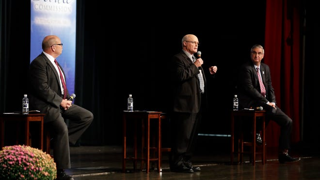 Libertarian Rex Bell (center) responds to a question during a debate in the Indiana governor's race Tuesday, Sept. 27, 2016. Democrat John Gregg and Republican Lt. Gov. Eric Holcomb also participated in the debate.