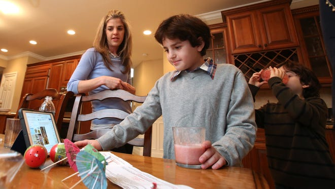 Jack Weiss, 11, and his mother, Alyssa, at their Suffern home March 25, 2015. Jack has EOE, a severe food allergy that affects the esophogus.