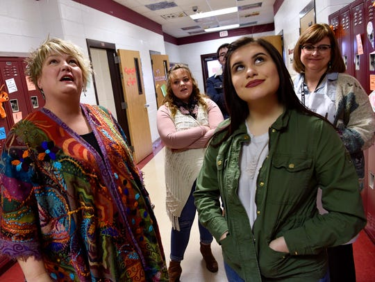 Charla Sims (left) and Lorene Pinales look up at the