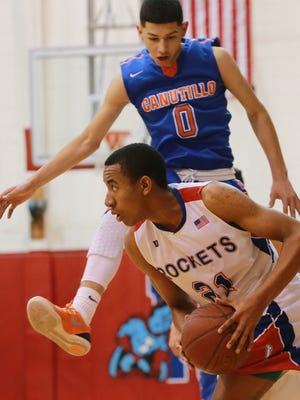 Irvin's Meshach Thornton looks to pass as Canutillo defender Isiah Sameniego flies past him Tuesday at Irvin.