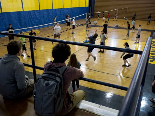Students in a recreational sports class play volleyball Friday, Feb. 5, 2016 at Port Huron Northern High School. The Fund Our Floor campaign reached its goal and $120,000 has been raised to replace the 51-year-old wooden gym floor. Now Northern will receive a new tennis court as part of a recent bond proposal.