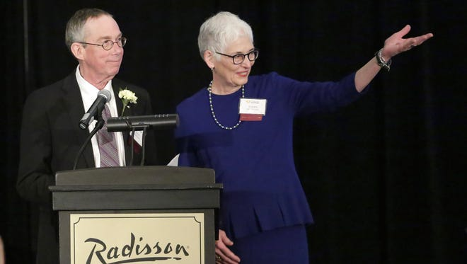 John and Susan McFadden receive the Health Care Volunteer Award Tuesday for their efforts with the Fox Valley Memory Project.
