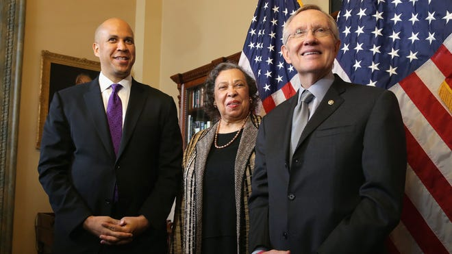 New U.S. Sen. Cory Booker, D-N.J., and his mother, Carolyn, meet with Senate Majority Leader Harry Reid on Oct. 31.