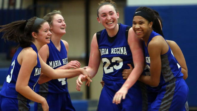 Maria Regina's Kaitlyn Downey (23) is mobbed by teammates after scoring her 1000th point during game against Eastchester during girls basketball tournament at Pelham Memorial High School Jan. 28, 2017. Maria Regina won the game 54-46.