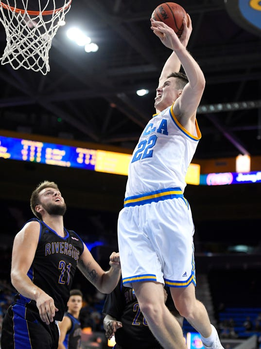 UCLA forward TJ Leaf, right, dunks as UC Riverside forward Alex Larsson defends during the second half of an NCAA college basketball game, Wednesday, Nov. 30, 2016, in Los Angeles. UCLA won 98-56. (AP Photo/Mark J. Terrill)