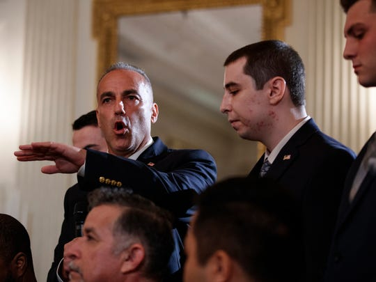Andrew Pollack, father of slain Marjory Stoneman Douglas High School student Meadow Jade Pollack, joined by his sons, speaks during a listening session with President Donald Trump, high school students, teachers and others in the State Dining Room of the White House in Washington, Wednesday, Feb. 21, 2018. (AP Photo/Carolyn Kaster)