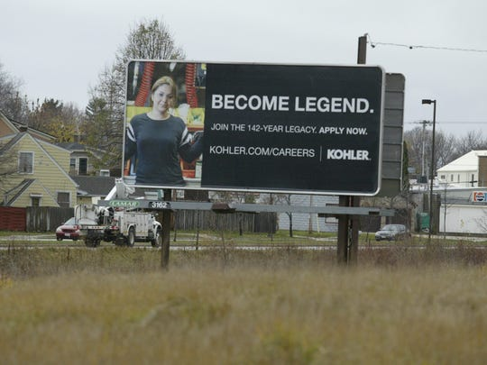 A billboard on South Business Drive encourages people