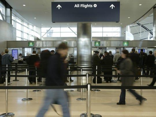 Travelers at Detroit Metro Airport.