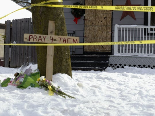 A makeshift memorial sits outside the home of the Maki