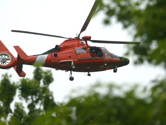 A Coast Guard helicopter like this one was involved in the search for missing boaters off the Brigantine coast this weekend.