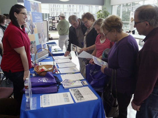 Prospective volunteers talk with Heather Byron of the American Cancer Society about volunteer opportunities at the organization during a volunteer fair at UW-Sheboygan on April 14.