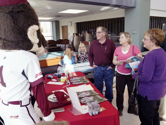 Vicky Verhage of Plymouth joins Suzette and Roger Vergowe of Howards Grove in asking Bill Weinaug and mascot A1 about volunteer opportunities at the Sheboygan Athletic Association during a volunteer fair at UW-Sheboygan on Thursday, April 14.