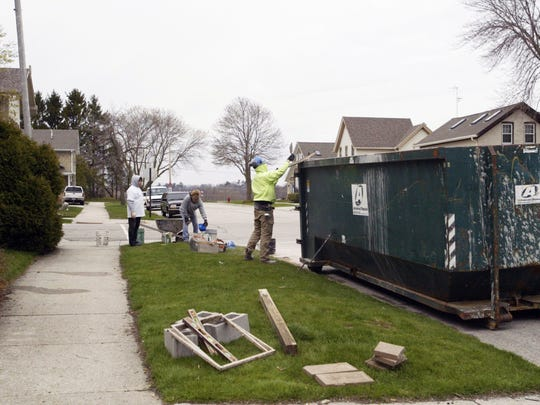 From left: Volunteers Shirley Ottman, Gina Theobald and Zach Theobald work to repair Walter Wiech's Sheboygan home on April 30, 2016, as part of Rebuilding Together Sheboygan County's National Rebuilding Day.