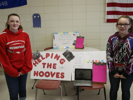 """Karlin Bruggink and Ana Beniger show off their project at Horace Mann Middle School's """"Make a Difference Day,"""" which consisted of them going to Free Spirit Riders in Fond du Lac to volunteer with disabled riders."""