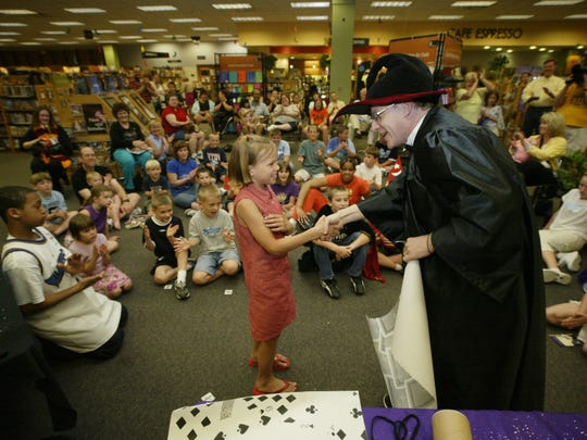 """In 2003, Erin Ellefsen, then 8, received a handshake from magician Kevin Holliday after helping him with a trick during one of the events leading up to the release of the """"Harry Potter and the Order of the Phoenix"""" at Border's."""