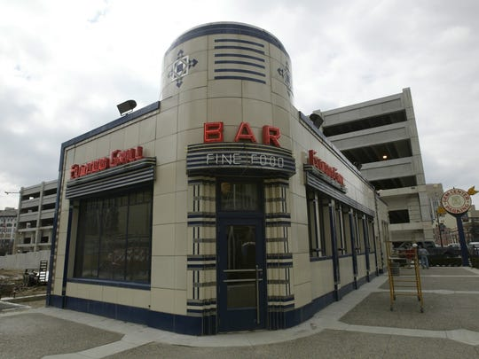 date:040102story: Elwood GrillCaption: The Elwood Grill, art deco diner/restuarant which moved from its orignial location on Woodward ave to 1745 Brush (at Adams) will be reopening. The Grill sits right behind the Comerica Park scoreboard.