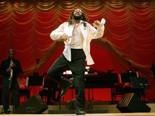 "Savion Glover dances a number during a dress rehearsal for ""Classical Savion,"" Jan. 4, 2005, at the Joyce Theater in New York."