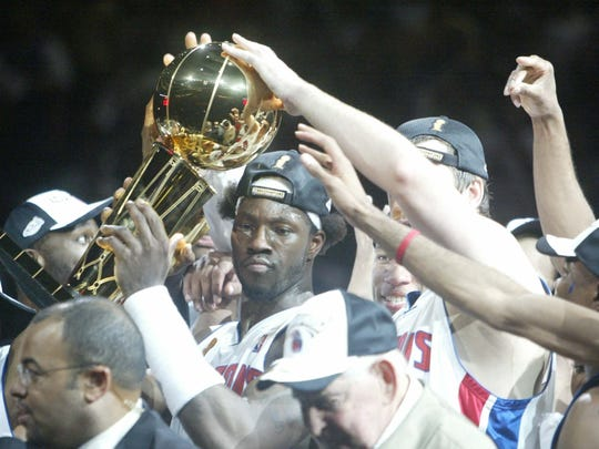 Detroit's Ben Wallace and teammates hold up the Larry O'Brien trophy after the Pistons defeated the Lakers 100-87 in Game 5 of the NBA Finals, Tuesday, June 15, 2004 at the Palace of Auburn Hills.