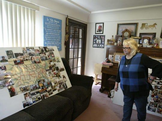 Laurie Hartmann, Adam Brey's grandmother, looks over