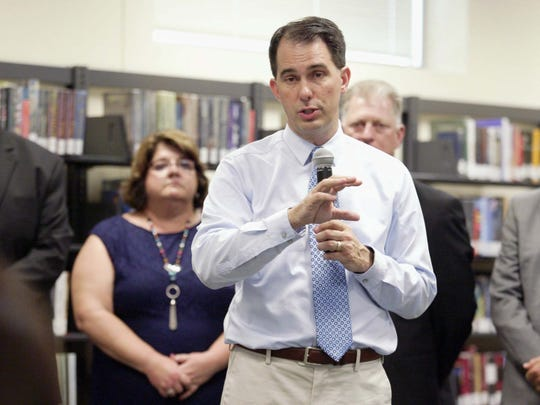 Gov. Scott Walker touts his proposed funding for K-12 schools in the state's next budget during a press conference June 12, 2017, at Sheboygan South High School. The governor was flanked by, from left, South High Principal Mike Trimberger; school board President Marcia Reinthaler; school board Vice President Mark Mancl; and Superintendent Joe Sheehan.