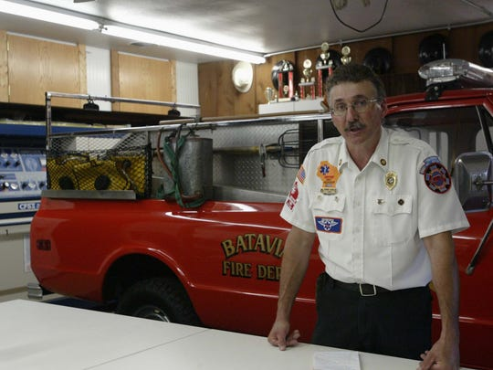 Former Batavia Fire Chief Dennis Schulz talks with a reporter last month inside the volunteer fire station in Batavia, Wis. The station ceased fire services earlier this year after the local town board opted not to renew its contract with the department, largely over low volunteer membership.