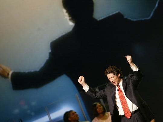 Pastor Joel Osteen  of Lakewood Church in Houston, Texas, speaks to thousands during a Night of Hope with Joel and Victoria at Palace of Auburn Hills, in Auburn Hills, Mich., on Friday, Oct. 24, 2008. KIMBERLY P. MITCHELL/Detroit Free Press