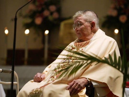 St. Genevieve priest Joseph Brennan celebrates his