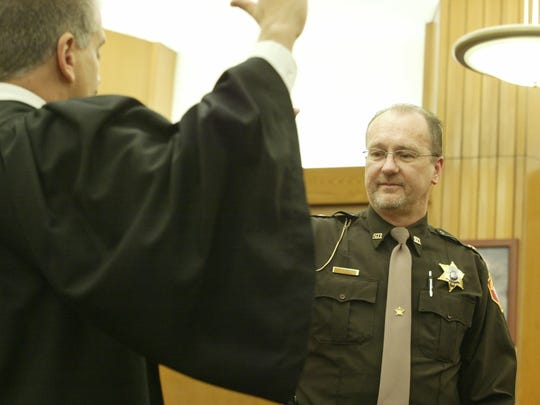 Cory Roeseler, right, is sworn in as Sheboygan County's new sheriff Wednesday, Jan. 3, 2018, by Judge Kent Hoffmann at the Sheboygan County Courthouse.