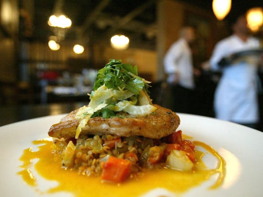 A pan roasted mahi-mahi with split peas, carrot-orange