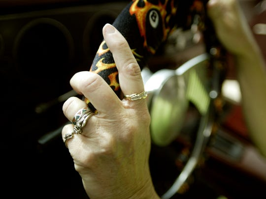 Betty Taylor wore all her wedding bands, including her 40th anniversary ring, as she drove her 1972 Camaro against her husband's 1970 Camaro during a 40th anniversary drag race between the two July 16, 2005, at the San Angelo Raceway in Wall.