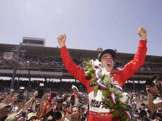 Helio Castroneves celebrates one of his three Indianapolis 500 victories.