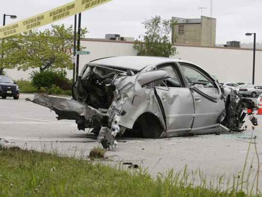A sedan had much of its back half missing and its front bumper nearly entirely torn off after it was involved in a multi-vehicle crash in Sheboygan on Friday, June 1, 2018