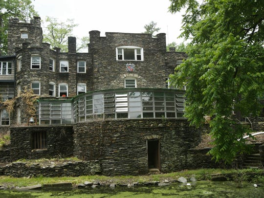 This May 5, 2004 photo shows the Tiedemann Castle in Greenwood Lake, N.Y., owned by former New York Yankees star Derek Jeter. The property features a 6-foot (1.8-meter) stone wall, a turret, an infinity pool, a lagoon and a small Statue of Liberty replica. It is on the market for $14.75 million. (Tony Savino/Times Herald-Record via AP)