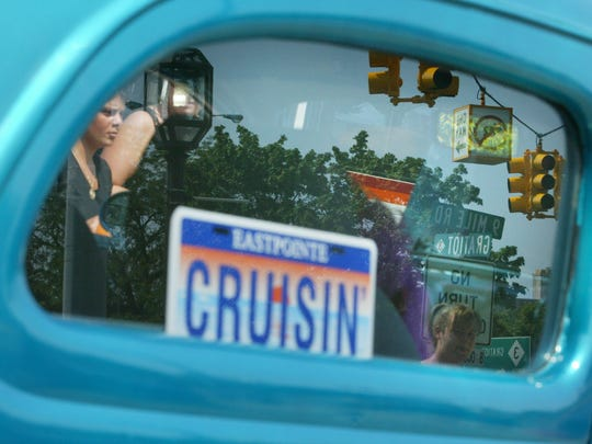 The intersection of 9 Mile and Gratiot roads in Eastpointe, is reflected in the rear window of a classic car at the Gratiot Cruise on Saturday, June 16, 2007.