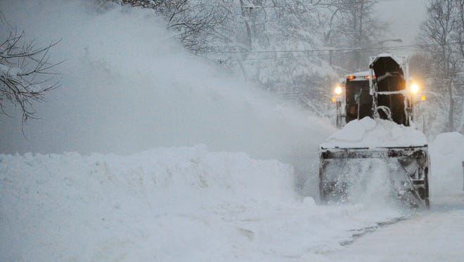 A New York State snowblower removes snow on Broadway in Lancaster on Wednesday.
