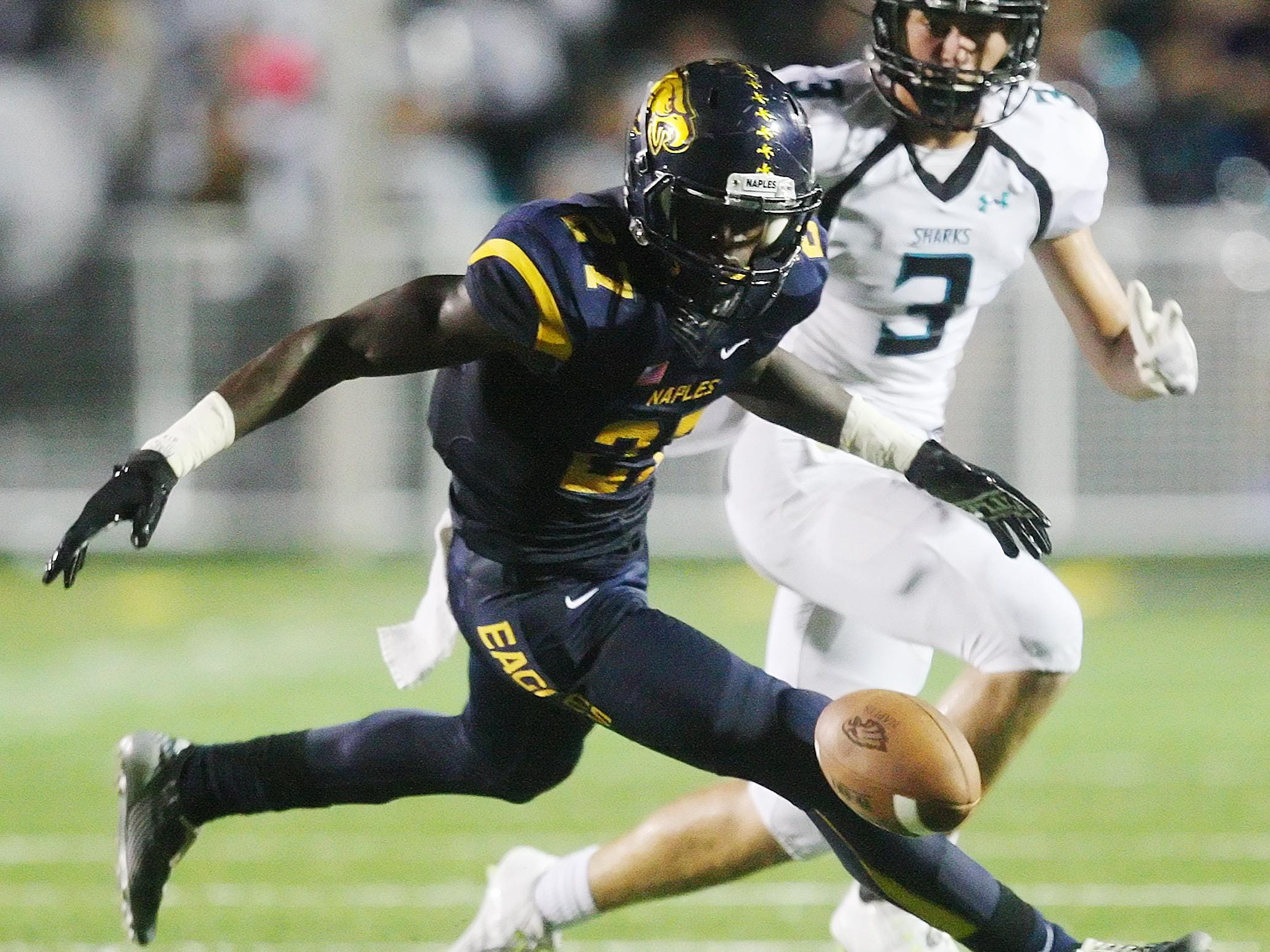 Naples High School's Carlin Fils-Aime recovers a fumble against Gulf Coast on Friday at Naples High School.