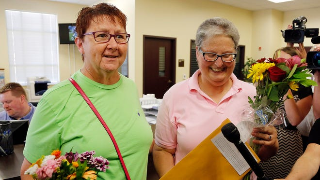 April Miller, right, and Karen Roberts exit the Rowan County (Ky.) Clerk's Office after obtaining their marriage license at the Rowan County Courthouse in Morehead, Ky., on Friday,  Sept. 4, 2015.