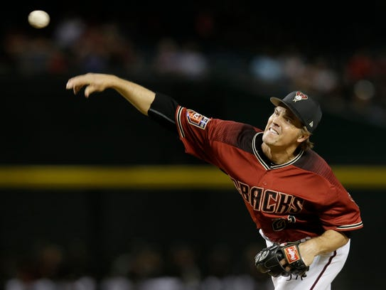 Arizona Diamondbacks starting pitcher Zack Greinke (21) throws in the fourth inning against the Cleveland Indians at Chase Field on March 26, 2018.