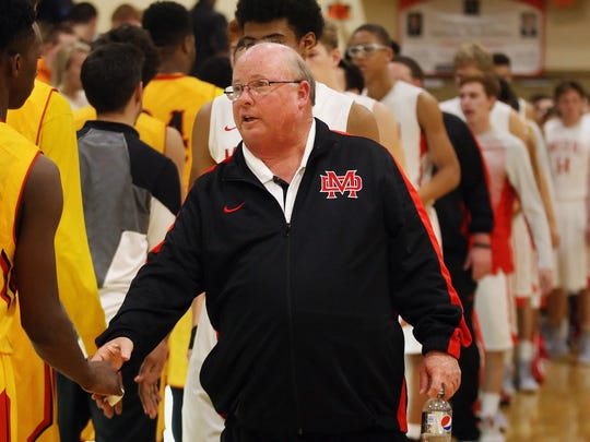 Mater Dei head coach Gary McKnight congratulates Wesleyan