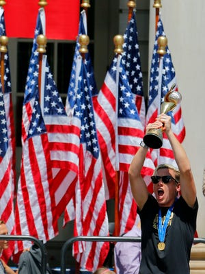 United States forward Abby Wambach celebrates during a parade in New York City to celebrate the 2015 FIFA World Cup title.