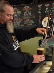 Eric Williams pours a pint of Not Today Satan at Mispillion River Brewing.